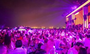 Crowds enjoy the drinks and the night-time view at Skybar, a rooftop bar in Beirut, Lebanon