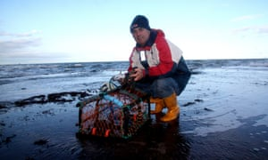 Sean Baxter with his lobster pot on Staithes beach.