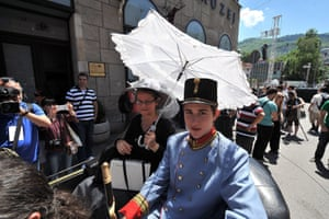 Tourists in costume at the street corner in downtown Sarajevo where Archduke Franz Ferdinand was assassinated.