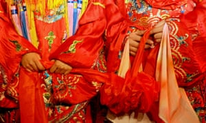 Traditional Chinese wedding of the living kind. The 'ghost marriage' – an ancient rite – is held to join the deceased in the afterlife.