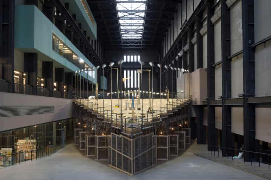 Empty Lot by Abraham Cruzvillegas in the Turbine Hall at Tate Modern, where 'bright lights keep a warm eye on 240 raised beds filled with soil from all over London'.
