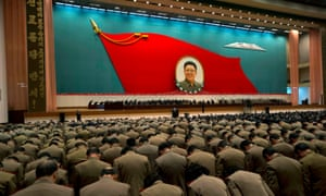 North Korean military officers bow at an image of late  leader Kim Jong-il.