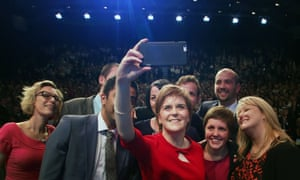 Nicola Sturgeon poses for a mobile phone photograph after delivering her speech at the Scottish National Party conference in Aberdeen