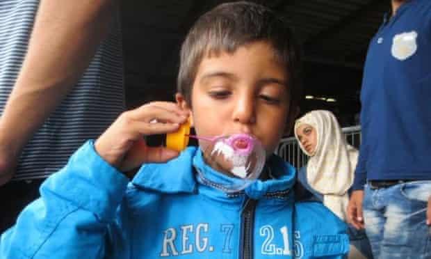 A child blows bubbles