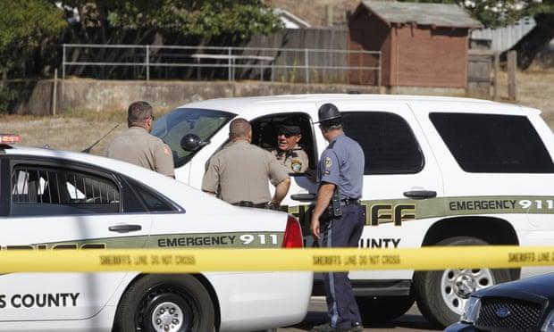 Sheriffs and police block the road that leads to the Umpqua Community College Shooting at Umpqua College, Roseburg, America.