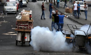 Tear gas erupts during clashes between Palestinians and the Israeli army in Hebron.