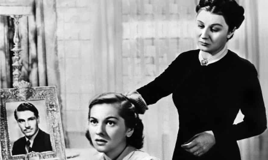 Judith Anderson as Mrs Danvers with Joan Fontaine in Rebecca.