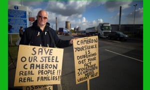Demonstrators protest in support of the UK steel industry outside the Tata Steel processing plant at Scunthorpe, after Tata announced job losses.