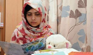 Malala Yousafzai reading get well cards at the Queen Elizabeth II hospital in Birmingham, 2012.
