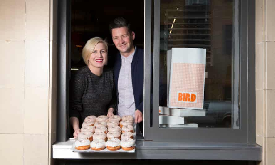 Paul and Clara pass a tray of doughnuts through the hatch at Bird in Islington.