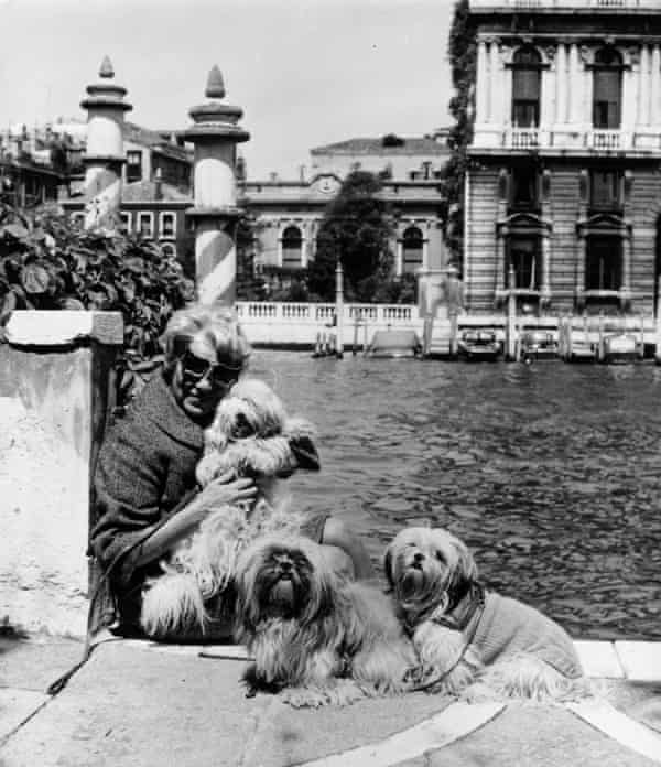 Peggy Guggenheim with her pet dogs outside her 18th-century Venetian palace on the Grand Canal,  1964.