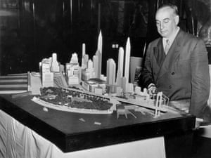 Robert Moses with a model of the lower end of Manhattan and the bridge with which it is proposed to connect Battery Park with Brooklyn, March 1939.