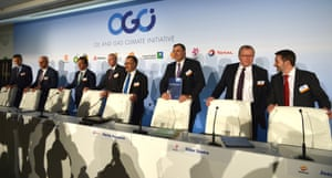 Oil company bosses announce their support for an agreement that keeps global temperatures within 2C on October 16, 2015 in Paris.