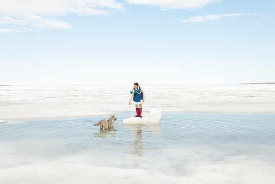 Arctic light: a girl playing with her dog in Tiksi, 2012.