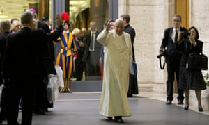 Pope Francis waves as he leaves at the end of the Synod of bishops at the Vatican.