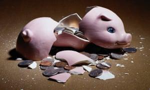 A broken piggy bank, with coins