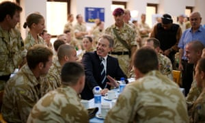 Tony Blair talks with British troops during a final visit as Prime Minister to Iraq