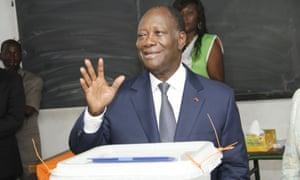 President Alassane Ouattara voting at a polling station in Abidjan.