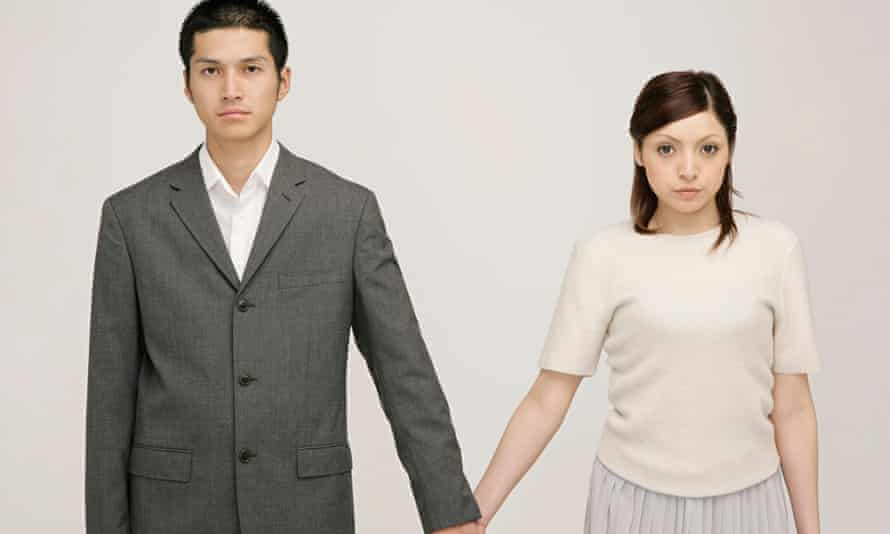 Young couple holding hands and looking nervous