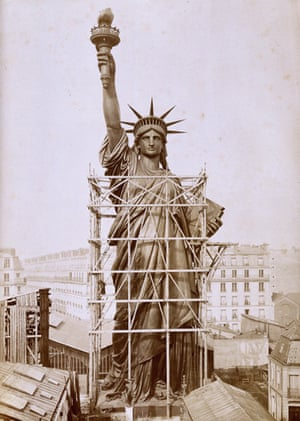 The Statue of Liberty towers over the Paris rooftops in 1884 before being shipped to New York.