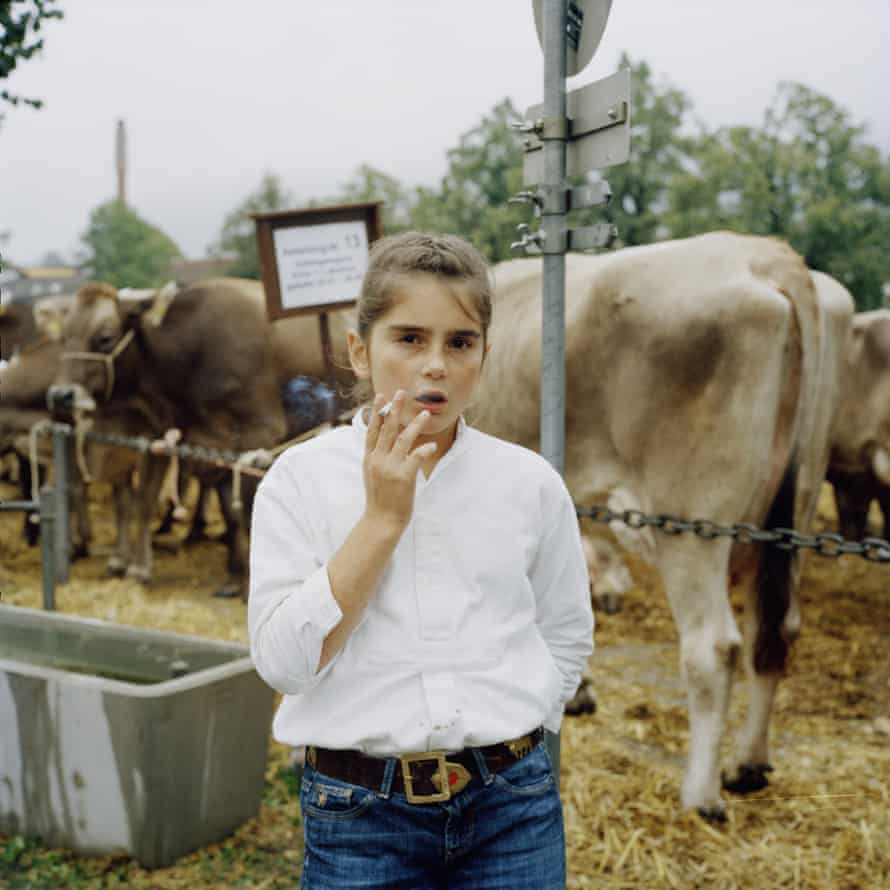A girl smoking at a cattle show in Appenzell, Switzerland by Jiri Makovec