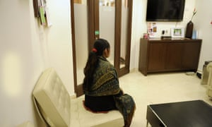 An Indian surrogate mother sits at a surrogacy clinic in New Delhi.