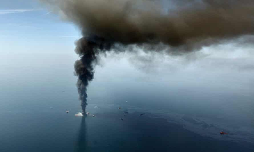 Smoke and oil stream from the burning Deepwater Horizon rig after it exploded in April 2010.