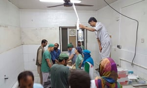 Afghan MSF surgeons work in an undamaged part of the hospital after the operating theatres were destroyed