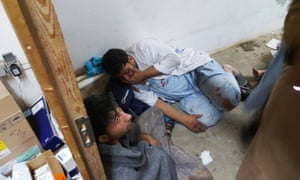 Afghan MSF staff shelter in one of the undamaged parts of the hospital