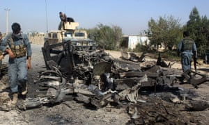 Afghan security forces inspect the site of a US airstrike in a different part of Kunduz