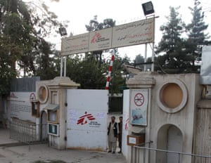 Afghan guards stand at the gate of the MSF hospital