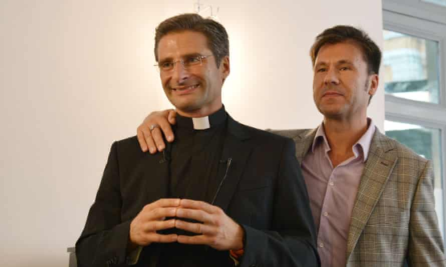 Father Krzysztof Charamsa and his partner Edouard at their press conference.