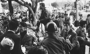 French soldiers trying to keep order during an insurrection, Algeria, 1960.