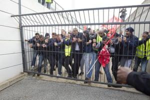 Air France union activists break through a gate