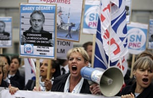 Employees of Air France shout slogans and hold a placard reading 'Gagey get away!'