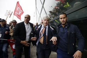 Director of Air France Pierre Plissonnier is helped by security officers