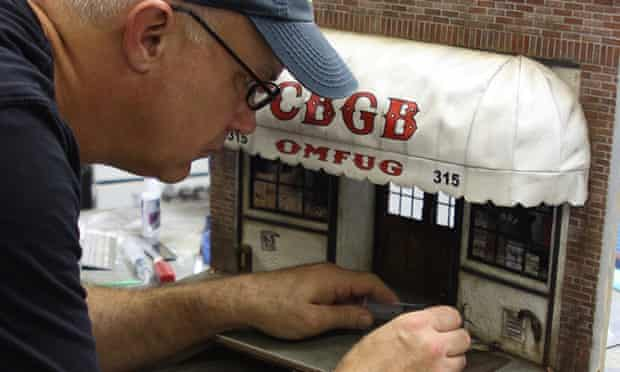 Artist Randy Hage works on a miniature of legendary punk club CBGB.