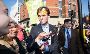 Egg on his face: a Conservative party delegate is egged during an anti-austerity march in Manchester city centre.
