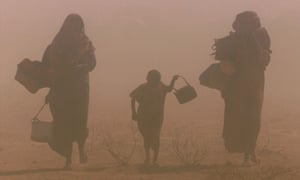 Displaced people walk though a dust storm in drought-stricken southeast Ethiopia.