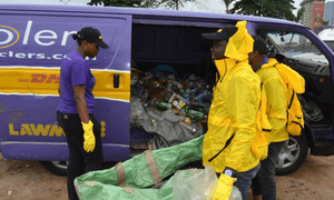 The Wecyclers team sort the collected recyclable goods.