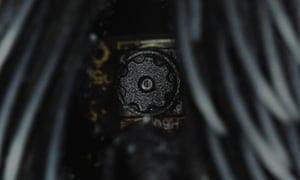 The hidden camera in the garmet.
