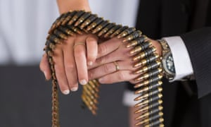 A couple shows their wedding rings with group of shell casings and bullets on their hands, in Las Vegas, Nevada.   The Gun Store in Las Vegas is offering extraordinary new  Shotgun Weddings  where couples seal their vows by shooting a firearm of their choice.
