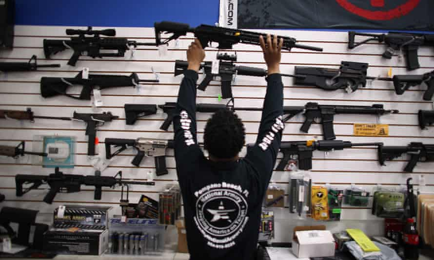 POMPANO BEACH, FL - APRIL 11:  As the U.S. Senate takes up gun legislation in Washington, DC , Mike Acevedo puts a weapon on display at the National Armory gun store on April 11, 2013 in Pompano Beach, Florida. The Senate voted 68-31 to begin debate on a bill that would significantly expand background checks for gun sales.  (Photo by Joe Raedle/Getty Images)BusinessCrimeFinanceJusticeLawRetail