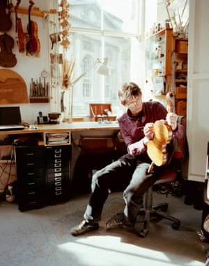 Andreas Hudelmayer polishing a violin in his Clerkenwell studio