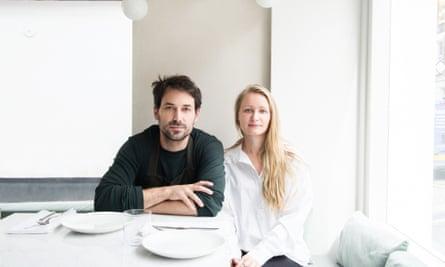 Nemanja Borjanovic and Melody Adams sitting side by side at a set table