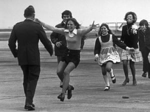 Released prisoner of war Lt Col Robert L Stirm is greeted by his family at Travis air force base, California, on his return home from the Vietnam War, 17 March 1973. In the lead is Stirm's daughter Lorrie, 15, followed by son Robert, 14, Cynthia, 11, wife Loretta and Roger, 12.