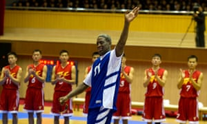 Dennis Rodman in 2014, waving to North Korean leader Kim Jong Un before an exhibition basketball game featuring US and North Korean players.