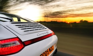 A Porsche Carrera drives into the distance. The company will include Apple's CarPlay, not Android Auto, in its 2017 911.
