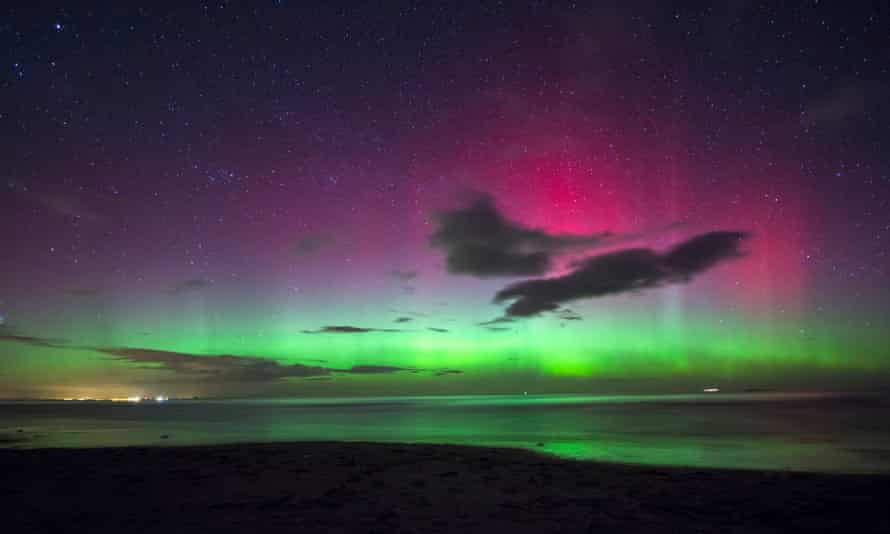 A view of the northern lights seen from Bamburgh Castle Beach, Northumberland.