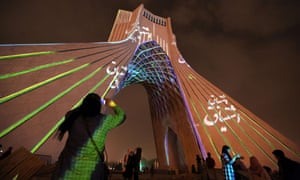 A visual installation by German visual artist Philipp Geist is seen projected on the Azadi Tower, also known as Freedom Tower, in Tehran.